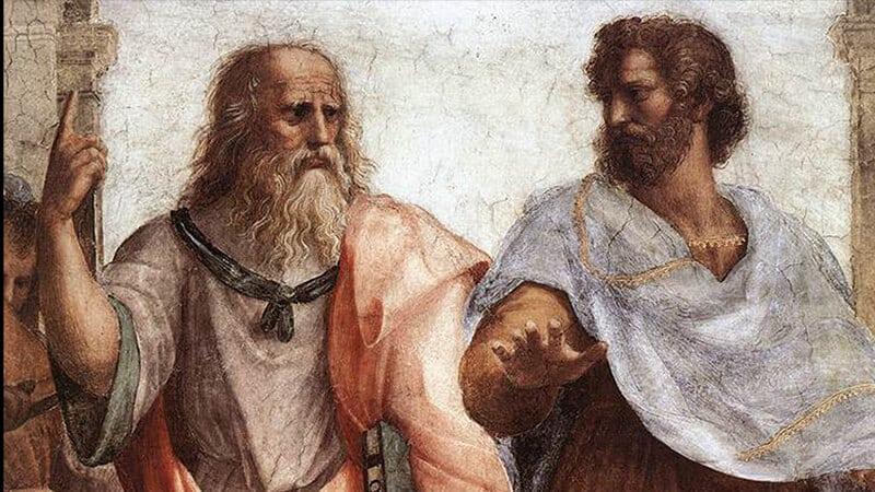 Platon (links) zeigt nach oben und Aristoteles (rechts) gleicht aus. Bildausschnitt aus